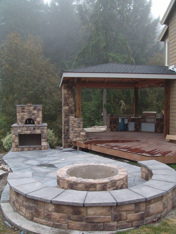 Outdoor living pizza oven, outdoor fireplace, seating by fireplace, columns, patio, stone, | Yelp: