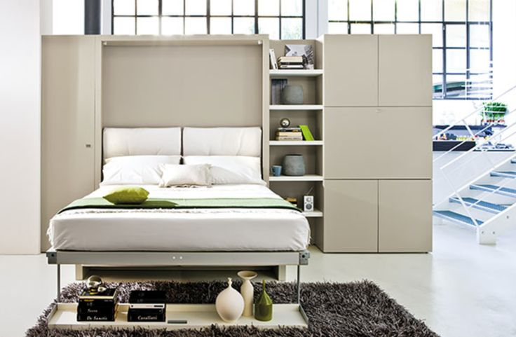 Folding storage that converts shelf into a spare bed.