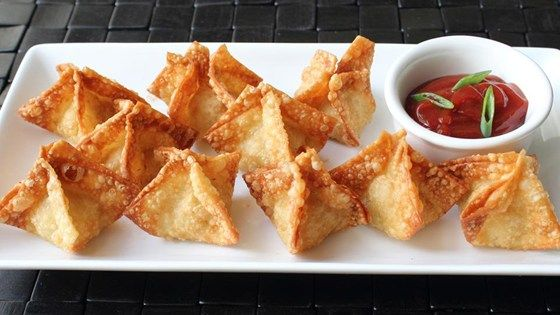 These deep-fried crab and cream cheese wontons contain just as much crab meat as cream cheese. They're served with a spicy sweet-and-sour dipping sauce.