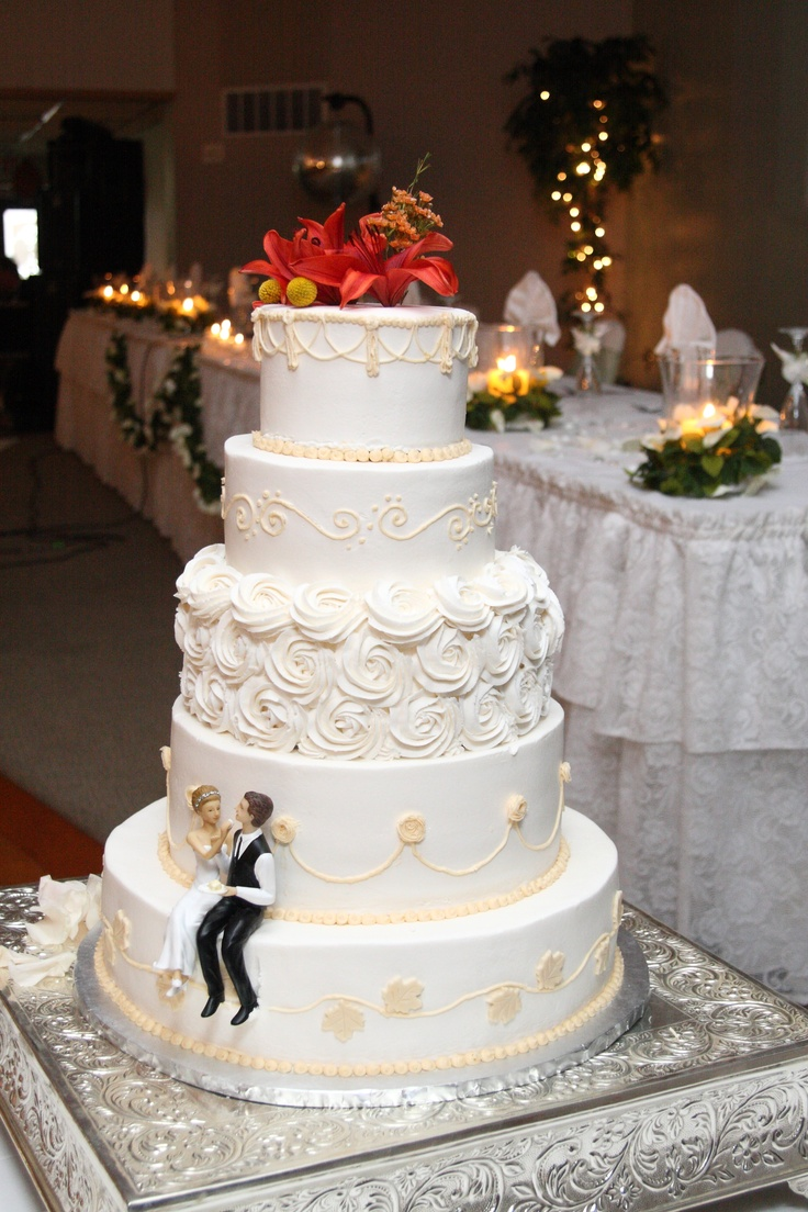 My fall wedding cake, flavors included pumpkin spice filled with cream cheese, chocolate filled with peanut butter, and almond sour cream filled with fresh strawberry puree.
