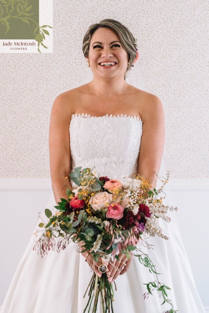 There's so much happiness in this photo that the flowers are almost an afterthought. We love this unstructured bouquet of roses, ranunculus and sweet pea, surrounded with pieris, egg and bacon, gum and trailing budded star jasmine. Gorgeous! www.jademcintohsflowers.com.au mattsphotography.com.au