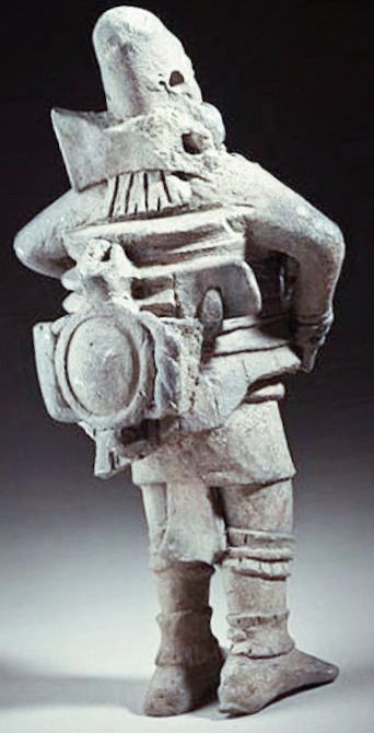 ANCIENT statue of someone wearing a protective suite with what appears to be high tech. Equipment. WHO MADE THIS? WHAT IS THE MESSAGE THAT THEY LEFT HERE FOR HERE THOUSANDS YEARS AGO FOR THE FUTURE GENERATIONS ON PLANET EARTH!? WHAT DO YOU SEE?? WHAT DO YOU THINK?? WHAT DO WE KNOW??