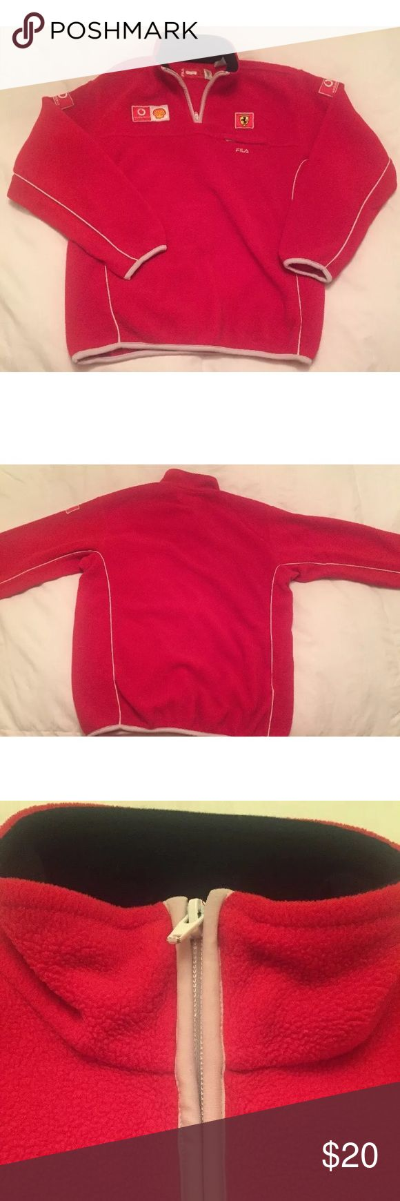 Fila Ferrari Fleece Sweater This is a size large in juniors boys. Has Vodafone and Shell symbols. Front collar zipper. White trimming. Front left chest pocket. Please view pictures carefully for sizing. Fila Shirts & Tops Sweaters