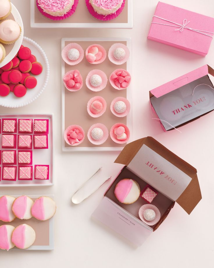 """Invite bridal shower guests to get their sugar rush on in style. Line Petite Party Studio bakery boxes with vellum, and let guests mix and match confections to their liking.The Details:Baked vanilla cupcakes, bakednyc.com.Charbonnel et Walker champagne truffles, bergdorfgoodman.com. Raspberry """"Mini Me"""" meringues, dominiqueansel.com. Trolli strawberry puffs, groovycandies.com. Pink-and-white cookies, wmgreenbergdesserts.com. Petits fours, dragonflycakes.com. Pink dot cookies, elenis.com."""