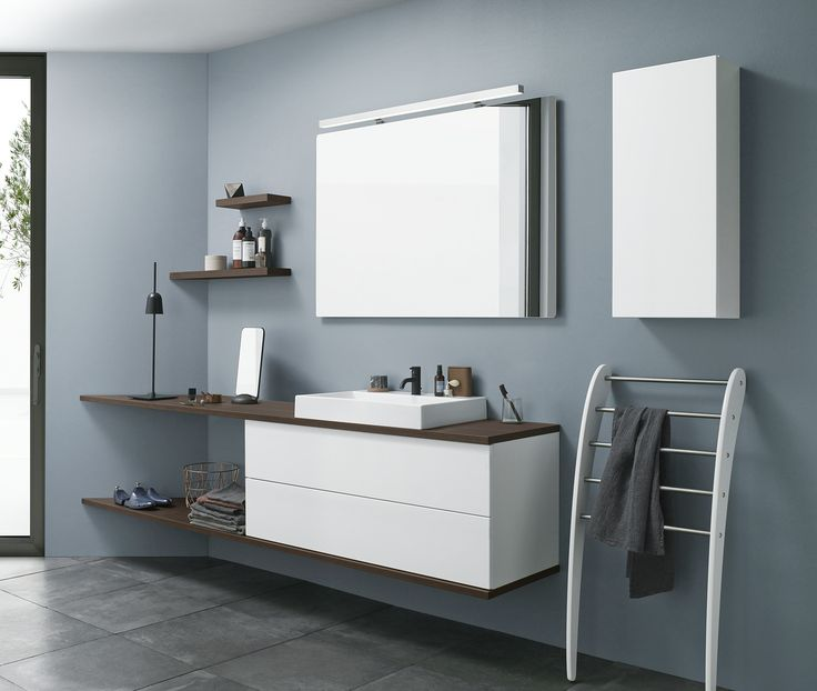 Skew walls is no problem for a long counter top, as they can be simply cut down to slide snugly into the unusual angles. Vanity unit and wall cabinet with push open function.