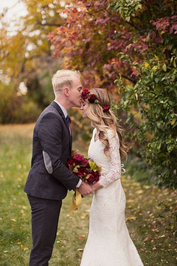 Such a pretty shot of a romantic fall wedding with the bride and groom | http://www.weddingpartyapp.com/blog/2014/11/11/15-romantic-fall-wedding-photos-thatll-convince-fall-wedding/