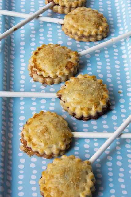 Pie Pops :  1 box Pillsbury Refrigerated Pie Crust,    1/2-3/4 cup fruit preserves*,    1 tablespoon unsalted butter, room temperature,    24 lollipop sticks,    1 egg white,    Turbinado sugar for dusting