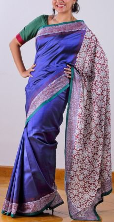 Sheer shiny purple opulence spells magic when highlighted with an off-white-maroon border and big off white floral block prints on the noel silk pallu. A thin green band runs along the border of the saree.Truly a festive attire! SHOP AT www.ubikaa.com