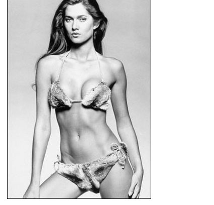 Hey. North Carolina, how do you think this fashion model, Caroline Cossey, would do in a men's bathroom?