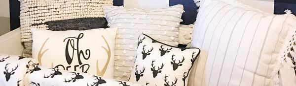 This amazing eclectic baby boy's nursery is everything & more! Get inspired by the buffalo check plaid wall, deer baby bedding, or amazing black & white accents