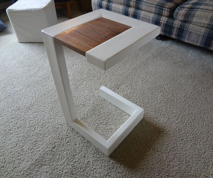 Today I will show you how to build a modern end table with just a 2x4 and some scrap wood. I got the idea from a picture I saw one time and decided i would make it for the 2x4 contest.Tools: Miter saw SanderBand sawMaterials: 10' 2x4 Walnut scraps Screws Plugs
