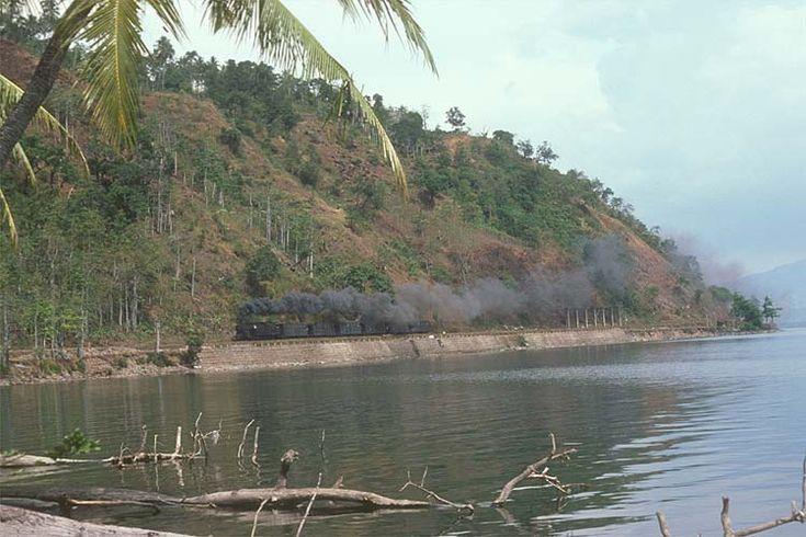 F10 hauling coal wagons at Lake Singkarak, 1977.