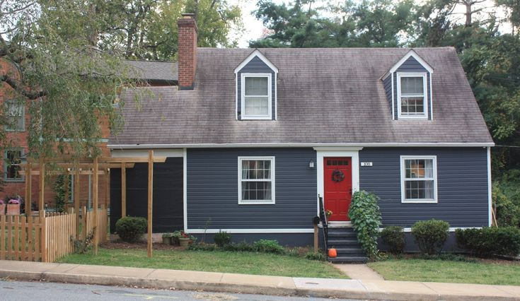 Not my house, but my house is blue with white trim and I am loving the red door :)