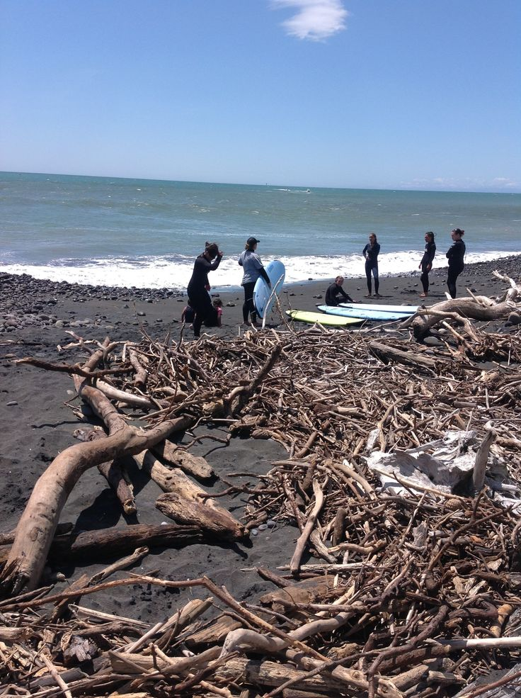 Taking surf lessons, not phased by the driftwood that the river pushes out the mouth from time to time