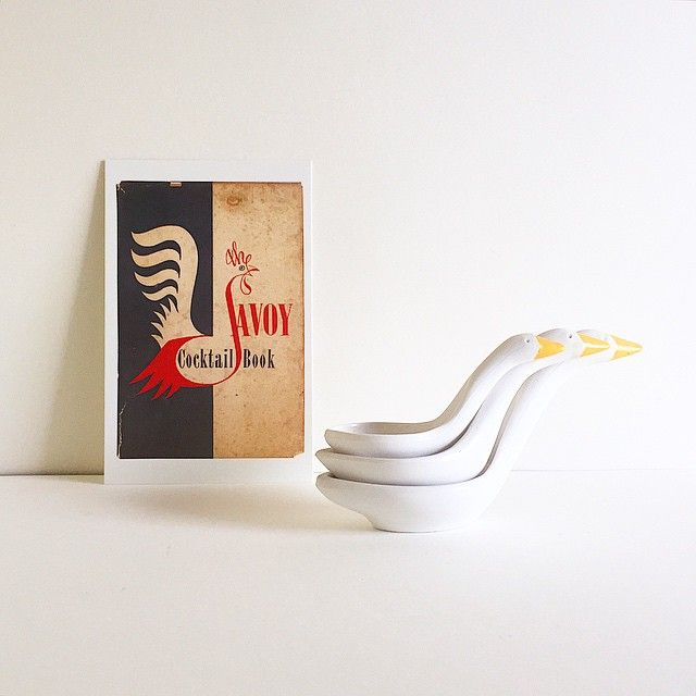 Postcard of The Savoy Cocktail Book, 1952, illustrated by Peter Goffin (Constable & Co ltd). And some plastic nesting geese measuring spoons, of course. #penguincookerycards #johnhamilton