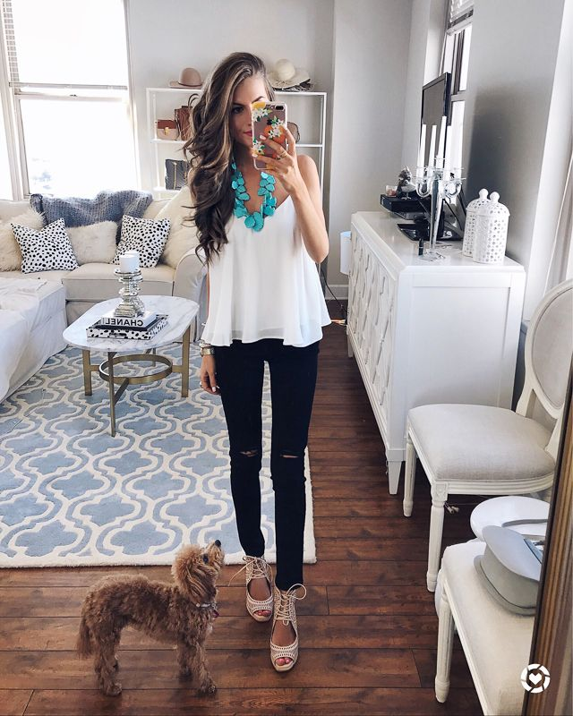 white tank, turquoise necklace, black pants