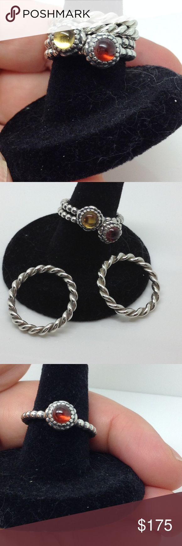 Set of 4 Pandora Sterling stacking fashion rings Firm price. Intertwined PANDORA Ring in sterling silver offers a twisted design that is also perfect for stacking with other rings in the PANDORA collection. January's Red garnet and November's yellow citrine birthstone Sterling silver stacking rings pandora Jewelry Rings
