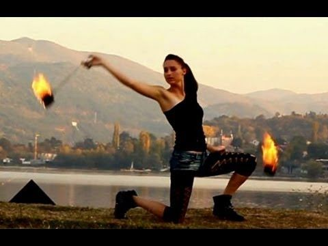 Love this girls and her control over the poi, great music and video!
