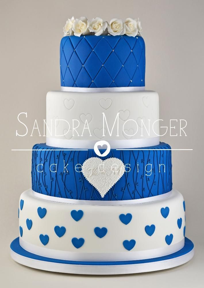 Cobalt Blue and White Wedding Cake with Mixed Designs. The idea of the layout is nice but not the designs