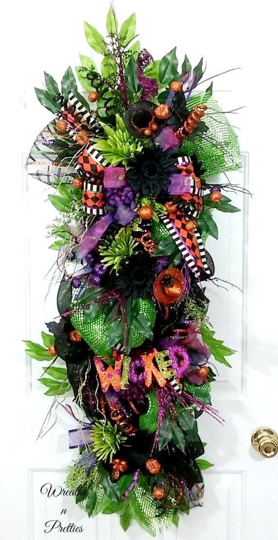 Halloween deco mesh swag,Halloween wreath,Halloween deco mesh wreath,Halloween swag,Halloween decor,XL wreath,XL swag,black wreath by OverAndBeyondDesigns on Etsy https://www.etsy.com/listing/239889227/halloween-deco-mesh-swaghalloween