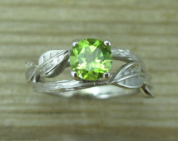 holy wow!! lookit this thing <3 Peridot Engagement Ring Leaf Engagement Ring With by Benati