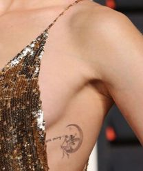 Lily Collins Fairy Tattoo
