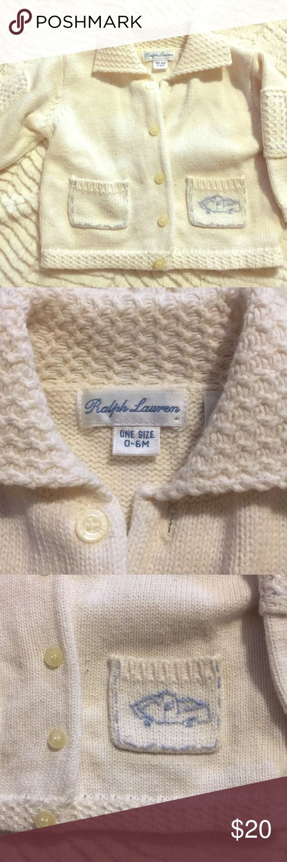 Ralph Lauren cotton baby boy sweater cardigan Ralph Lauren 0-6 month baby boy sweater cardigan. In perfect condition. Cream colored with blue stitching on pockets and elbow patches. Blue truck embroidered on front left pocket. No rips stains or tears. 100% Cotton. Button up front. Smoke free pet free home. Bundle and save! Ralph Lauren Shirts & Tops Sweaters