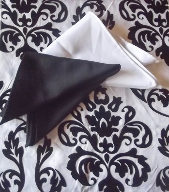 Set consists of a beautiful flocked taffeta damask table runner (2.8m x 30cm) and set of 8 mini matt napkins (40cm x 40cm) in either black or white. Visit our website www.everaftercreations.co.za and see our listings on Bid or Buy. We ship countrywide and offer discount for bulk orders.