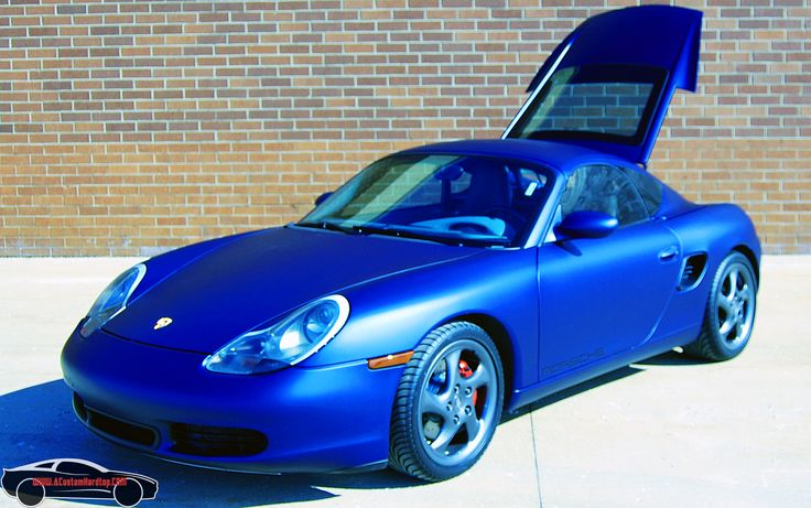 The hardtop fits snug to the hood of the Porsche Boxster.