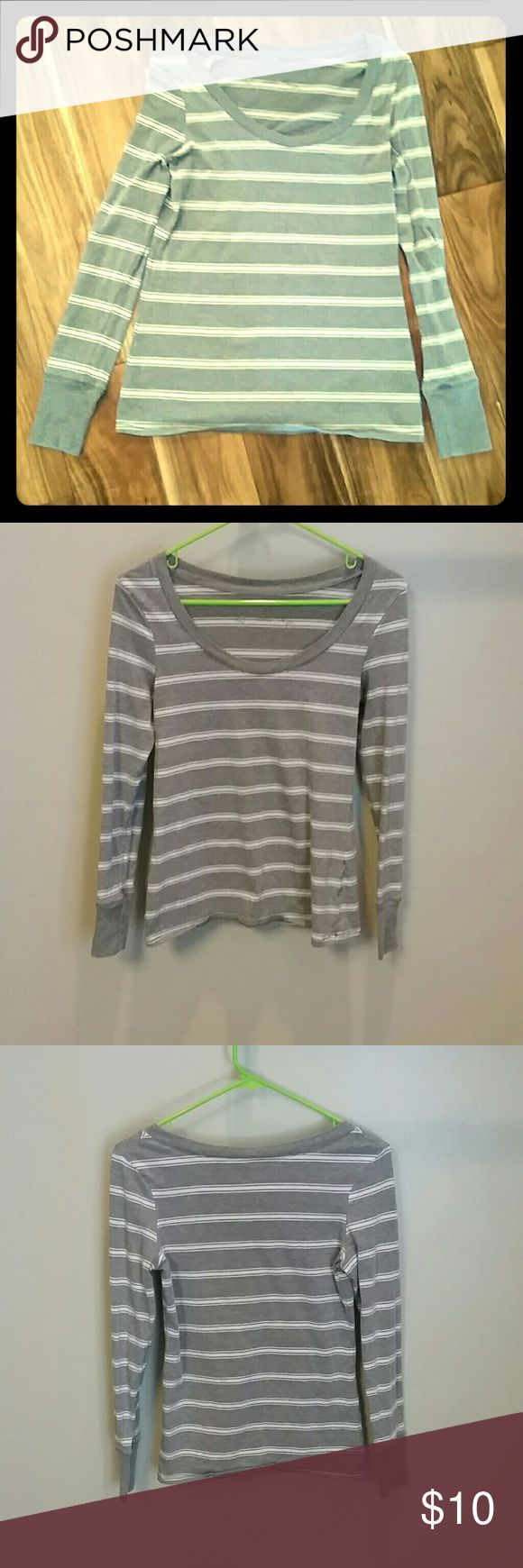 Size medium women's striped long sleeve shirt Size medium long sleeve women's shirt. Gently used with no holes or stains. Pair with a vest and/or long colorful necklace for a fun, stylish outfit. Tops Tees - Long Sleeve