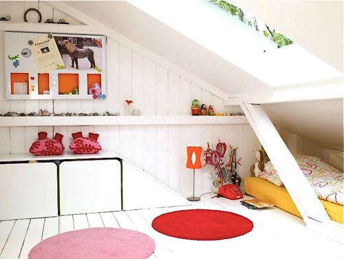 12 White Rooms with Pops of Color: Photographer Espen Grønli captures a child's room. Who else but the tiniest human could sleep under such a low pitched room? Love the pink and red circle rugs and the yellow wrapped mattress.