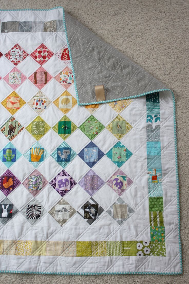 I Spy Economy Block Scrappy Quilt // Michael Ann Made -- love this concept, and the classy grey backing.