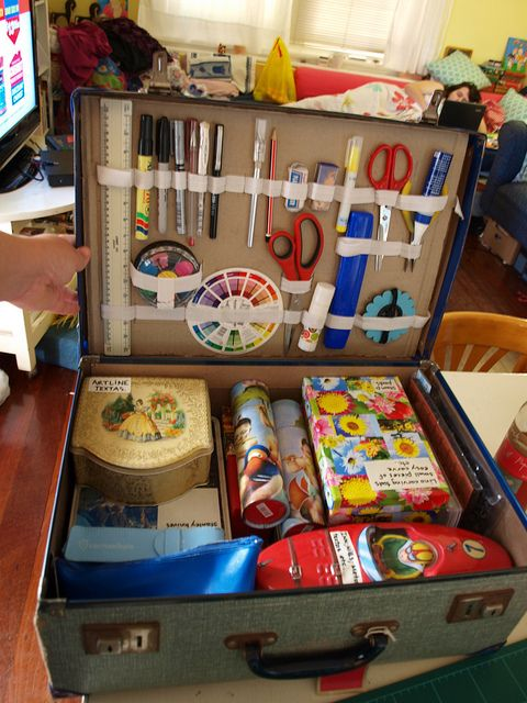 storage for art supplies in a vintage suitcase. I want to try this with a wooden case I have.