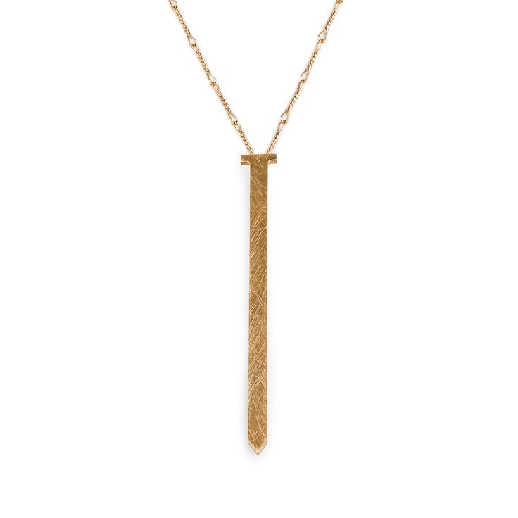 "Nail pendant by NOILENCE, from their Luminous collection.  Materials: Chain-- Brass, Pendant-- Gold-plated brass.  Measurements: Chain-- 37 cm (14.5"") on each side, Pendant-- 8.5 cm x 0.5 cm (3.3"" x 0.2"")  Designed in: Greece  Crafted in: Greece"