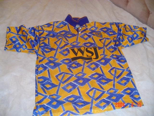 My favourite Shrewsbury Town shirt. Disgusting you say? You try choosing a kit out of the multitudes of identical striped shirts STFC have made over the years.