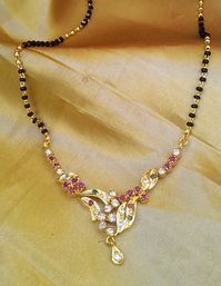 Handcrafted Mangalsutra in semi precious ruby , emerald and zircons.