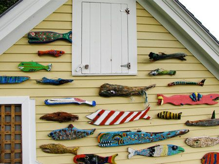 driftwood carved into fish & painted, very cool