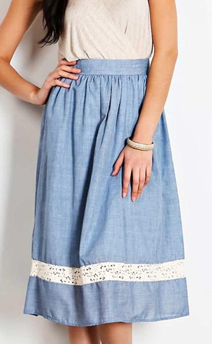 """Chambray midi skirt with lace panel. A-line fit. Made in USA 80% polyester, 20% cotton Model is 5'8"""" & wearing size small Final sale on all sale items. May exchange sizes."""
