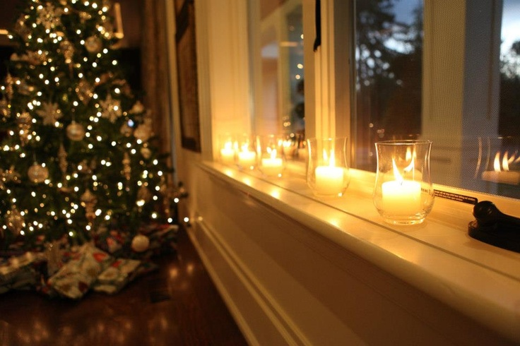 Gorgeous Christmas tree decorations with luminous candles.