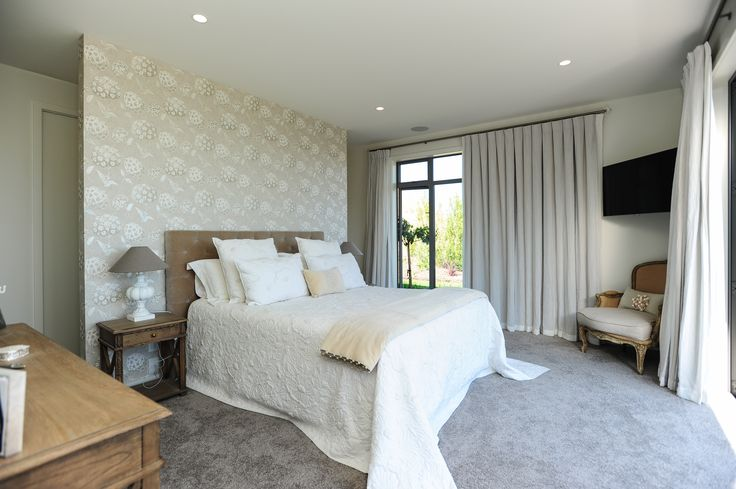 The master bedroom sits in its own wing of the home, the other side of the living areas to the guest bedrooms.