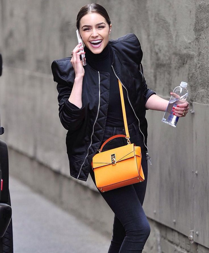 Spotted! Olivia Culpo rocks the mini-bag trend with the new Uptown Mini Satchel and a gorgeous smile.