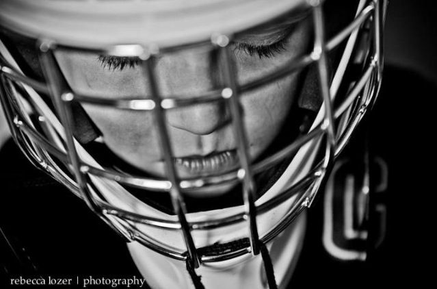 Hockey player getting focused.  Black and white photography.