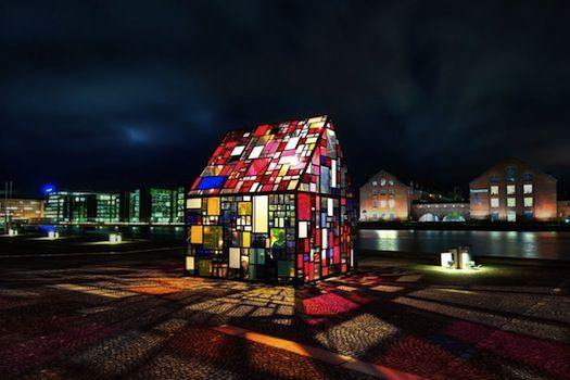 Outdoor installation made with welded steel picture frames and found plexiglas by NY-based Tom Fruin.
