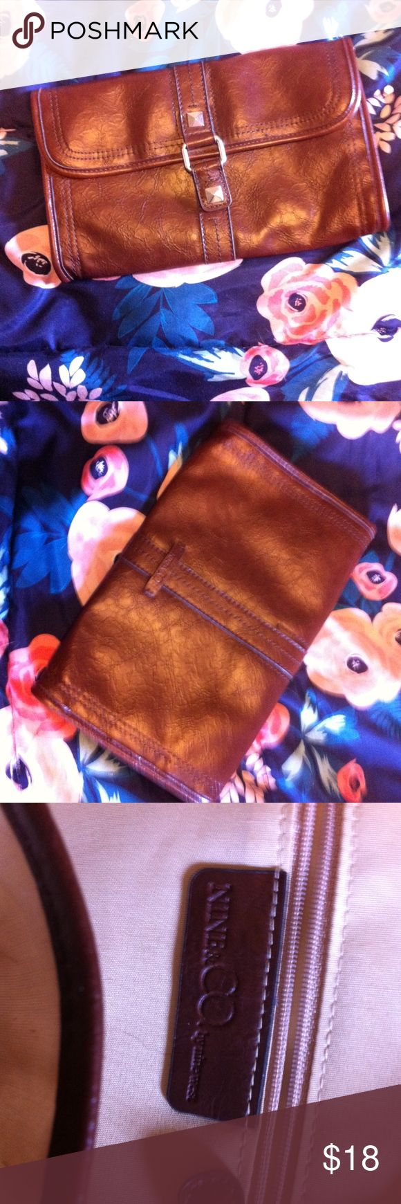 Nine & Co. Faux Leather Brown Clutch Make me an offer on this item! All $6 items are final price, however they are Buy 1 Get 1 Free! Free Gift With Purchase. Bundle & Save, 3+ items gets you 15% off!  Condition: Preowned Made In: 2000s Flaws: None Unique Details: Clutch style Closure Details: Clasp Retails For: $25 Brand: Nine & Co. Color: Brown & Silver  Questions? Comments? Concerns? Message me!  SMOKE FREE HOME! Comes from a home with pets. Wrapped & Shipped with care. Nine & Co. Bags…