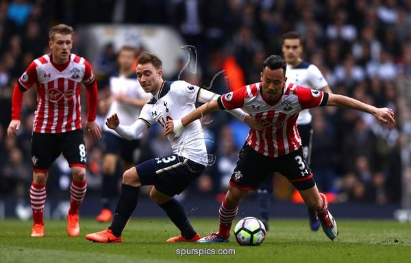 LONDON, ENGLAND - MARCH 19: Christian Eriksen of Tottenham Hotspur (L) and Maya Yoshida of Southampton (R) battle for possession during the Premier League match between Tottenham Hotspur and Southampton at White Hart Lane on March 19, 2017 in London, England