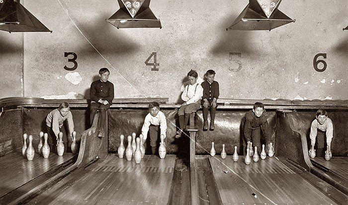 Before automatic pinsetters were invented pin boys worked to manually line them up. 1914 .