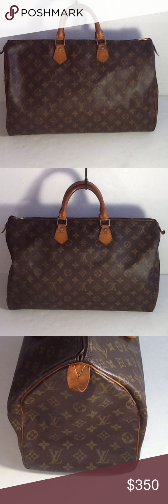 Authentic Louis Vuitton Speedy 40 Monogram Satchel The leather and strap showed signs of used. The canvas and inside linen are good. The bG was made in France with a date code SP 0962. The zipper pull leather piece got ripped. The bad had no lock and key. Louis Vuitton Bags Satchels