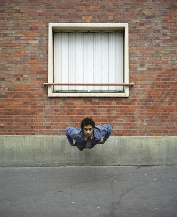 High Cognitive Effort. is he hanging or is the picture being taken from above?