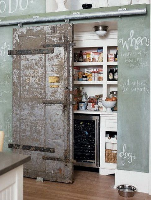 vintage sliding door could be a focal point of your kitchen while hiding your pantry - Shelterness