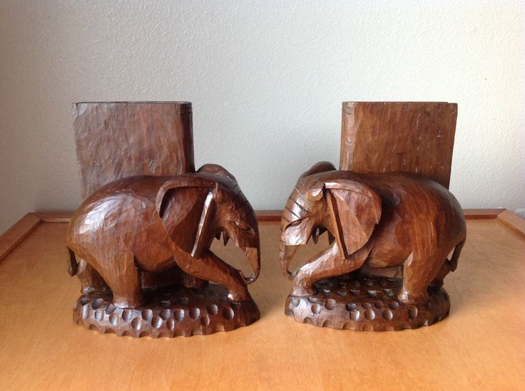 Vintage Wood Carved African Elephant Bookends by CharsGoodStuff on Etsy https://www.etsy.com/listing/227013678/vintage-wood-carved-african-elephant